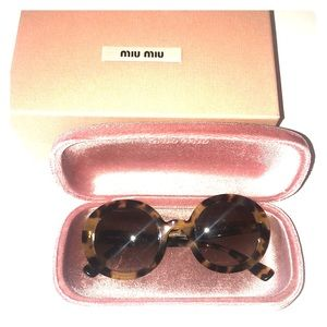 Sunglasses Miu Miu, Made in Italy.